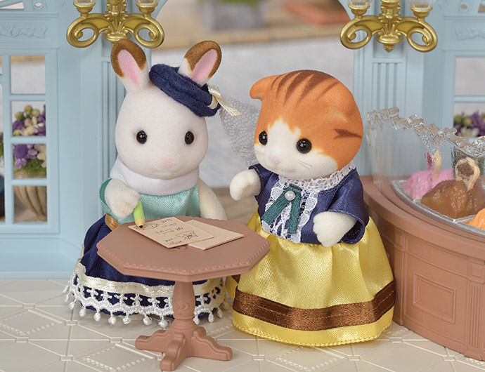 """Stella asked Georgina all kinds of questions. """"When is Millie's birthday?"""" she asked. """"And what's her favourite flower?""""  This was how Stella knew how to design the perfect dresses for everyone. She asked them their favourite flower and birth stone and used those in their dresses."""