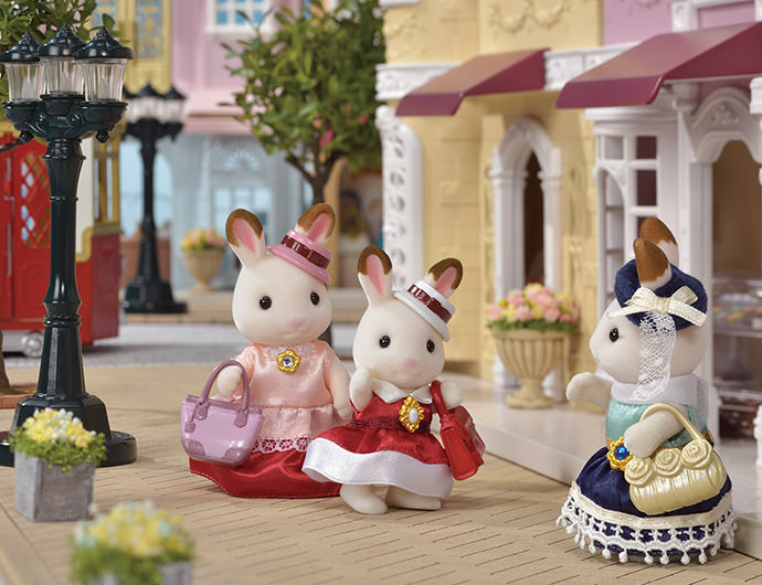 """Along with her dress for Freya, she designed a matching dress for thir mother. Teri the Chocolate Rabbit mother, so that Freya and Teri could wear them when they went out together.  Freya and Teri loved their new dresses. They came into town to meet Stella, wearing their lovely new dresses.  """"This dress is just what I wanted!"""" said Freya happily.  Seeing Freya and Teri so happy made Stella very happy indeed."""